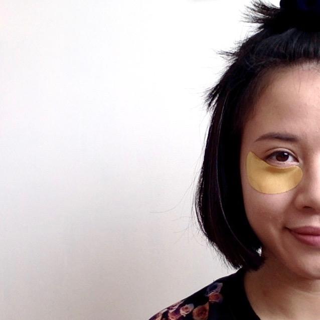 Asian girl with golden eye mask