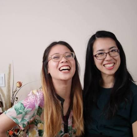 2 asian girls smiling