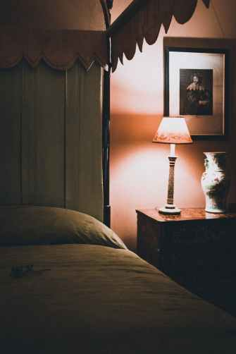 turned on white table lamp